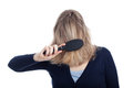 Woman covered her face using hairbrush Stock Photography