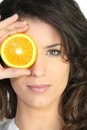 Woman covering eye orange Royalty Free Stock Images