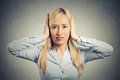 Woman covering her ears avoiding unpleasant rude situation Royalty Free Stock Photo