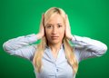 Woman covering her ears avoiding unpleasant rude situation closeup portrait attractive peaceful young isolated green background Stock Photography