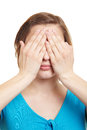 Woman covering her eyes Stock Image