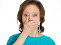 Woman covering mouth, speak no evil Stock Photos