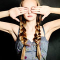Woman covers her eyes with her hands ignorance and stress concept Royalty Free Stock Images