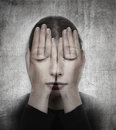 Woman covers her face with her hands on the grunge backround surreal concept photo manipulation Stock Photos