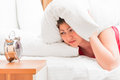 Woman covers his ears a pillow to sleep Royalty Free Stock Photography