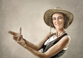Woman in cowboy hat, making gesture with hands pretending gun Royalty Free Stock Photo