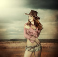 Woman in cowboy hat and sexy shorts young wearing outdoor Stock Images