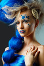 Woman with creative fantasy hairstyle beautiful fashionable young blue hairs and art make up Royalty Free Stock Images