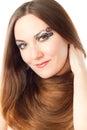 Woman with creative makeup, bodyart and long hair