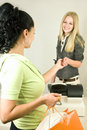 Woman with Credit Card at Register Royalty Free Stock Photo