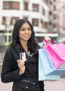 Woman with credit card and shopping bags outdoor Royalty Free Stock Image