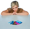 Woman with credit cards attractive collection of on the table making expression Royalty Free Stock Photo