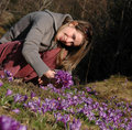 Woman in a crocus field Royalty Free Stock Photo
