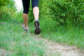 Woman cross country running on Stock Images