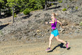 Woman cross country running in mountains Royalty Free Stock Photo