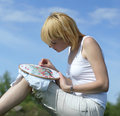 Woman cross-stitching in the park Royalty Free Stock Image
