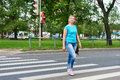 Woman crossing street is dangerous at red light the a Stock Photography