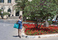 Woman crossing street in malta a young shopping the Stock Images
