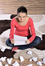 Woman crying reading letter unhappy young Royalty Free Stock Photo