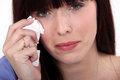 Woman crying into a tissue Royalty Free Stock Photography