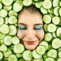 Woman and cucumber beautiful expression face with slice frame Stock Photo