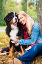 Woman cuddling with dog outside in park Royalty Free Stock Photo