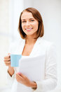 Woman with cup of coffee and folders business concept businesswoman in office Royalty Free Stock Image