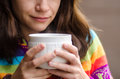 Woman with cup drinking hot chocolate from white Royalty Free Stock Images