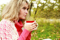 Woman with cup of hot tea in outdoor Royalty Free Stock Image
