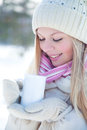 Woman with cup in winter Royalty Free Stock Image