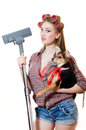 Woman with curlers and red lips holding puppy vacuum cleaner looking camera young on white background Royalty Free Stock Photos
