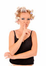 Woman with curlers saying be quiet funny shhh Stock Image