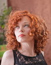 Woman with curly red hair portrait of beautiful long outdoors Stock Image