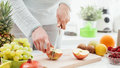 Woman cutting apples Royalty Free Stock Photo