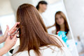Woman cutting her hair at the beauty salon Stock Photo