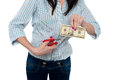 Woman cutting ten dollar banknote with scissors Royalty Free Stock Photo