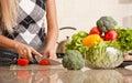 Woman Cutting Tomato Royalty Free Stock Photo