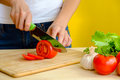 Woman cutting tomato fresh tomatos Royalty Free Stock Photo