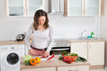 Woman cutting vegetables Royalty Free Stock Photo