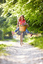Woman on cycle ride in countryside with legs the air having fun Royalty Free Stock Photography