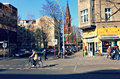 Woman cycles in urban environment a uses the bicycle lane kreuzberg berlin one of the hippest and trendiest areas of germany there Royalty Free Stock Photos