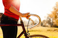Woman cycling on bicycle in autumn park Royalty Free Stock Photo
