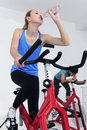 Woman cycling at the gym Stock Photos