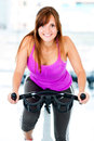 Woman cycling at the gym Royalty Free Stock Image