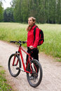 Woman cyclist on a bicycle walk on the nature Royalty Free Stock Image