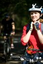 Woman cyclist in the park on a mountain bike Stock Image