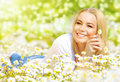 Woman on daisy field Royalty Free Stock Photo