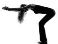 Woman dancer  stretching warming up exercises silhouette Royalty Free Stock Photo