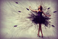 Woman dancing in a dress made of smoke and feathers Royalty Free Stock Image