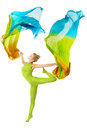 Woman dancing with fluttering flying colorful fabric over white flexible dancer background Stock Images